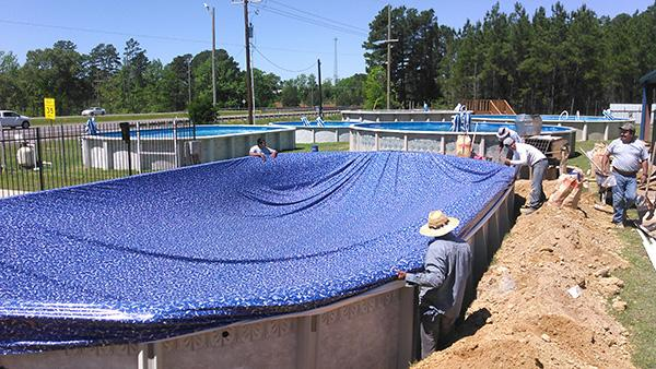 Stretching the liner over the pool
